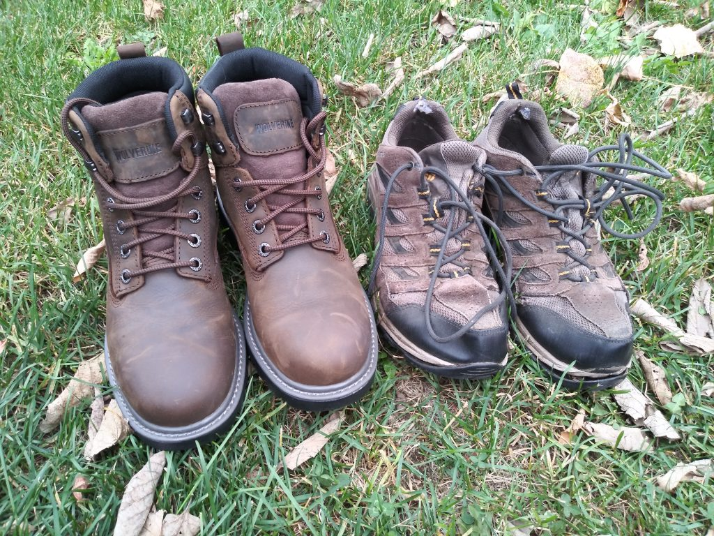 New work boots next to old hiking boots